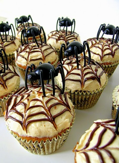 Cupcakes with cobweb icing and spider toppers