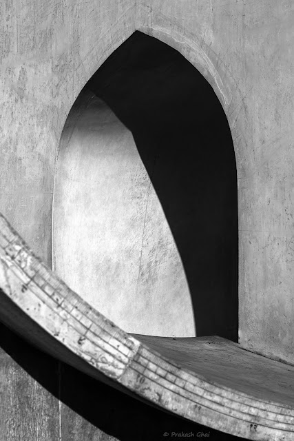 A Black and White Minimal Art Photograph of Arc versus Curve shot at Jantar Mantar, Jaipur, India.