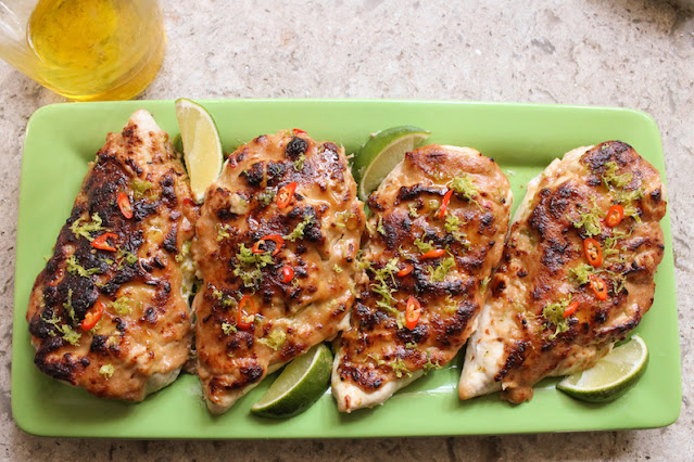 Food Lust People Love: This spicy lime peanut chicken recipe combines zesty lime juice with sweet and salty peanut butter to top boneless chicken breasts for a fabulously delicious main course.