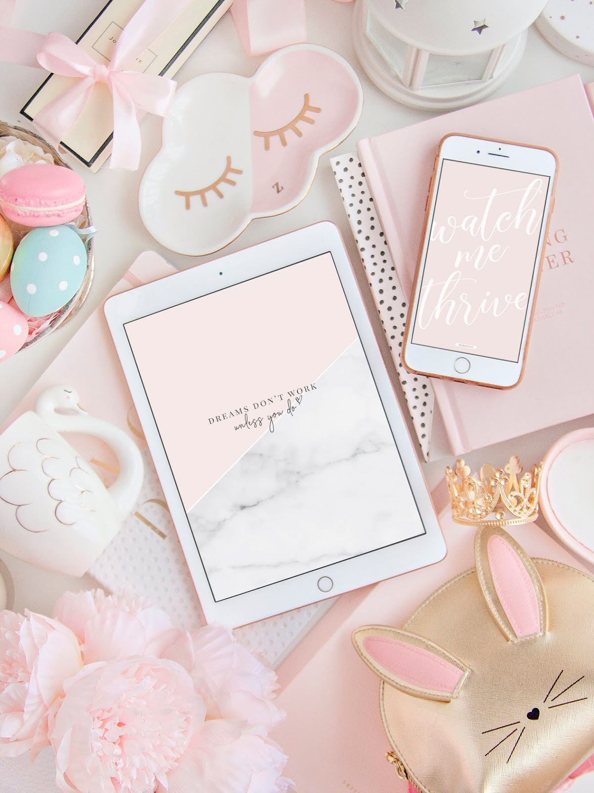 Flatlay image of motivational quote wallpapers on iphone and ipad