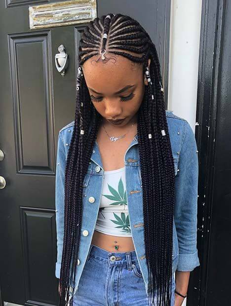 There are loose braids at the front too and also the hair is accessorized with beads ✘ 26 Best Tribal Braids Hairstyles Updos 2020 That Attract Beauty