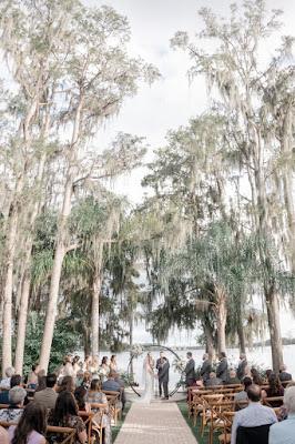 wedding ceremony with trees at paradise cove orlando