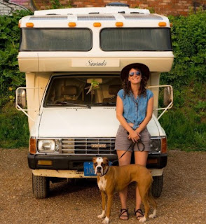 Chelsy Bakula with her dog while Van in the background