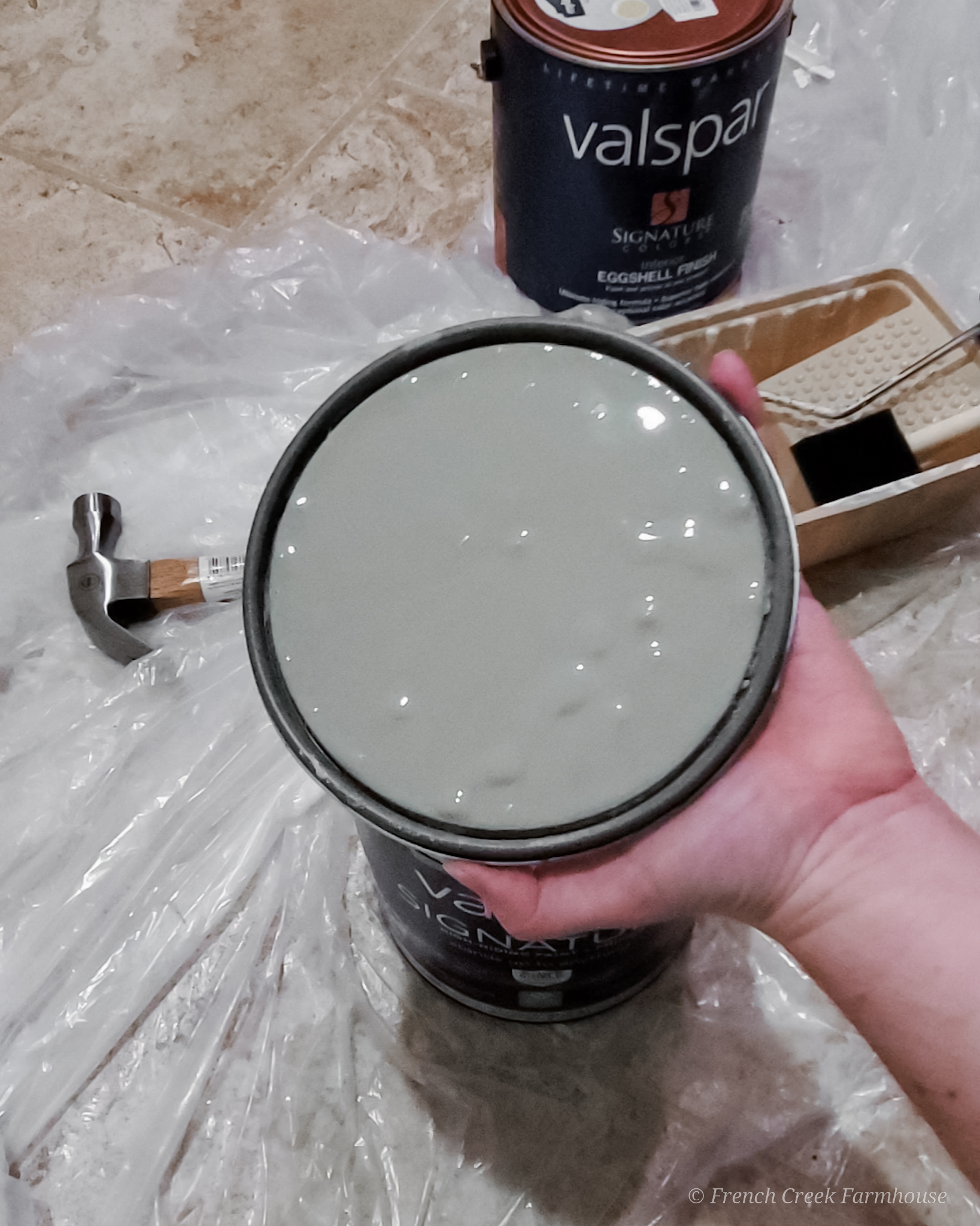 Revealing the paint color for the cabinets