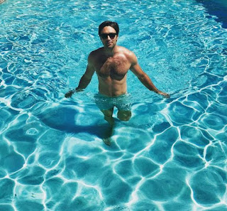 Carlo Marks posing for a picture in swimming pool
