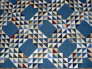 Matchstick quilting in the light triangles allows the blue ones to advance.