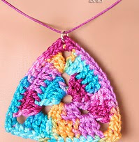 http://www.ravelry.com/patterns/library/perfect-symmetry-triangle-pendant