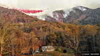 A heavy air tanker drops fire retardant over the Boteler wildfire near Hayesville, N.C., on Nov. 10. Credit: Reuters / Michael David Chiodini) Click to Enlarge.