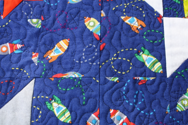 Devoted quilter finished friendship galaxy baby quilt for Galaxy quilt fabric