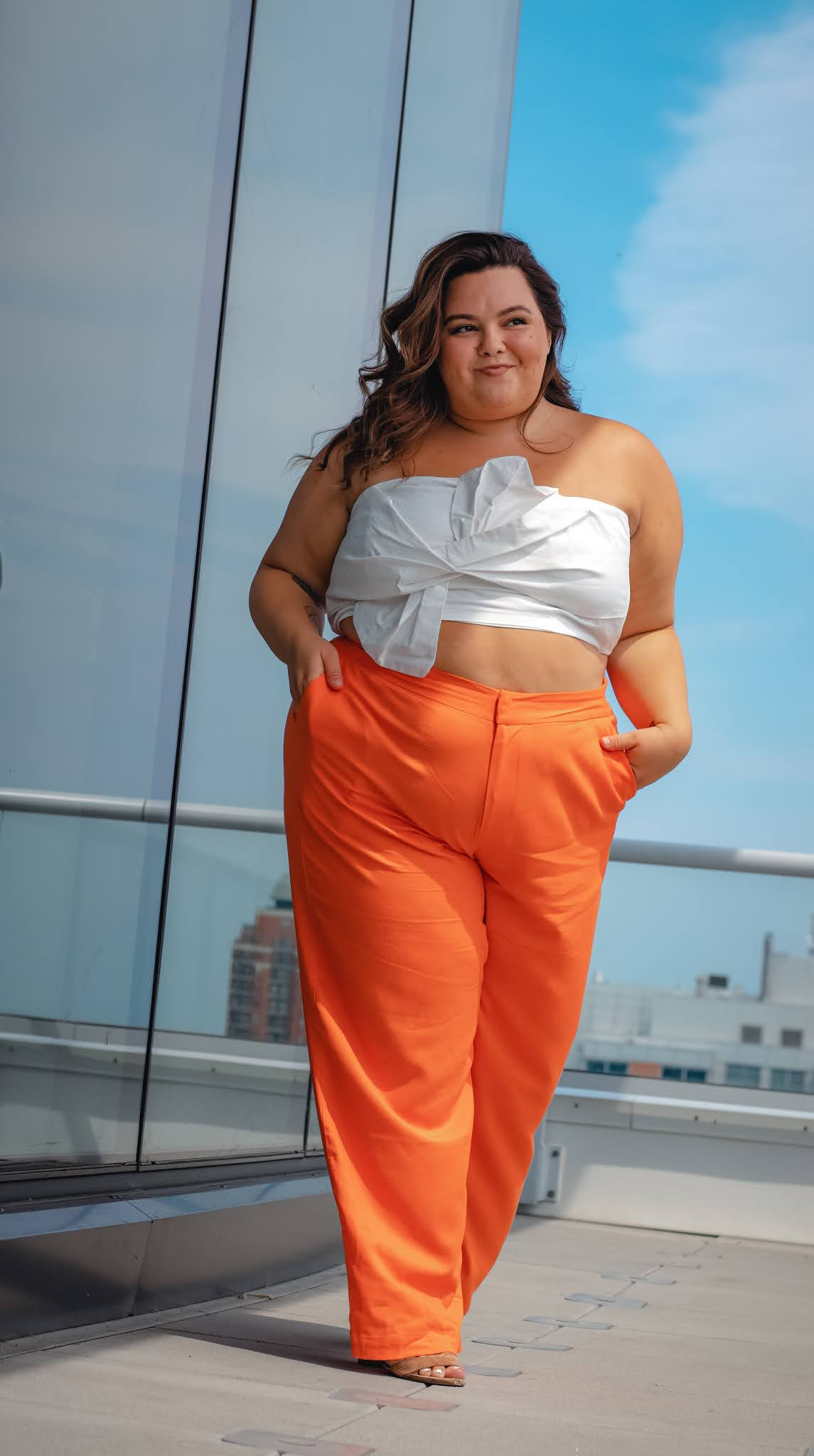 Plus-size and petite blogger and model Natalie in the City reviews the wide-leg pants she's wearing from Eloquii.