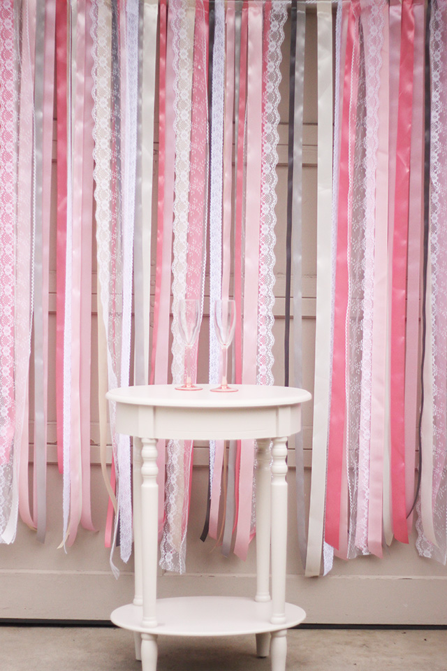 Pink Ribbon And Lace Backdrop with Wooden Table | DIY Photo Booth Ideas For Your Next Shindig