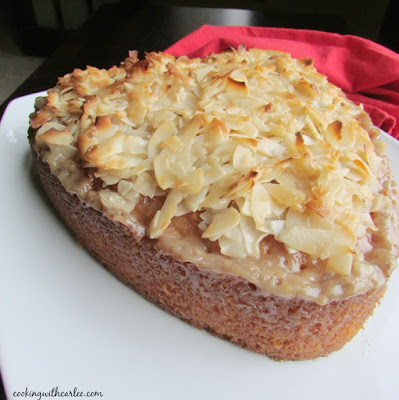 heart shaped Greek coconut cake on platter