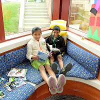 brother and sister reading at Olney