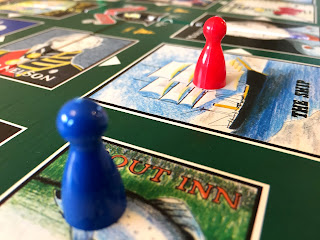 A two-player game of Inns & Taverns. The red player is far ahead of the blue player.