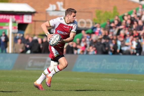 Dan Biggar of Northampton runs with ball in hand against Harlequins