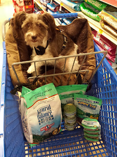 Image of Pixel Blue Eyes in a shopping cart filled with Natural Balance dog food items