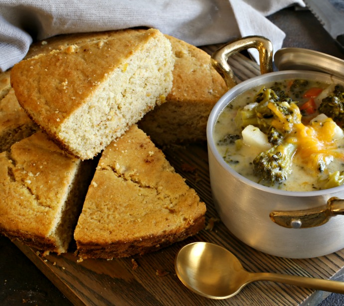 Recipe for a thick, chunky stew with broccoli, potatoes, carrots and cheddar cheese, served with cornbread.