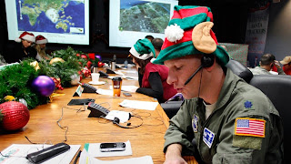 An Air Force Lt. takes a phone call from a child in Florida at the Santa Tracking Operations Center at Peterson Air Force Base near Colorado Springs, Dec. 24, 2010 file photo (Ed Andrieski/AP Photo)