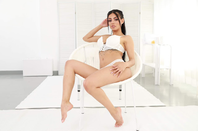 Canela Skin sitting hot on chair white lingerie hand on thighs