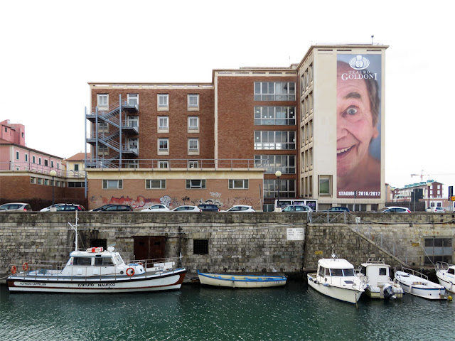A big ad for the season of the Goldoni Theater on a wall of the Nautical Institute, Livorno