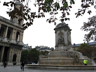 Worker clean up city fountain routine in Paris