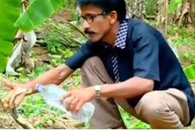 Man gives venomous cobra a drink from water bottle