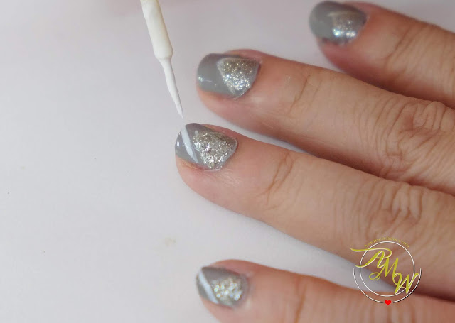 a photo of Nail Art tutorial, space gray nails by Nikki Tiu of www.askmewhats.com