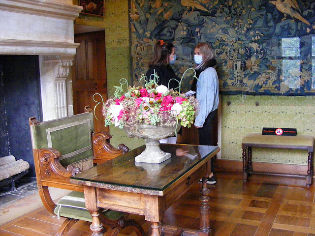 Wearing a mask inside a historic chateau. Indre et Loire. France. Photo by Loire Valley Time Travel.