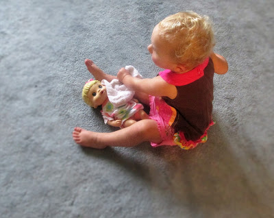 Grandbaby washing the baby doll