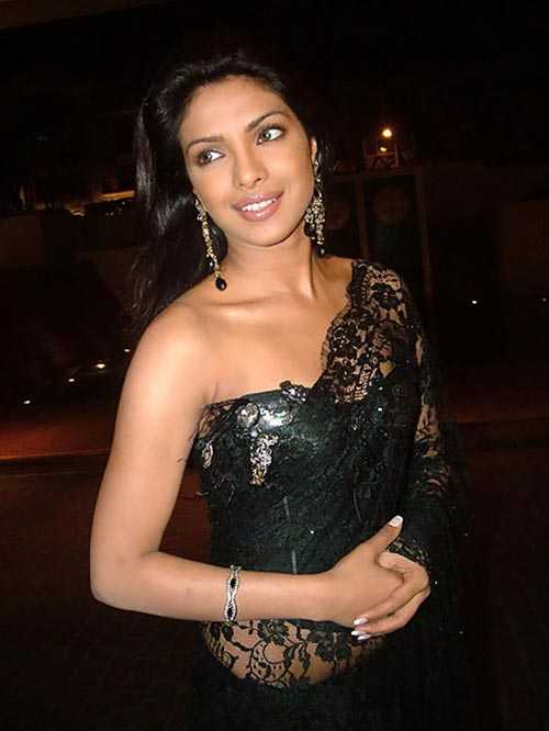 Priyanka Chopra in a sheer black saree with offshoulder blouse.