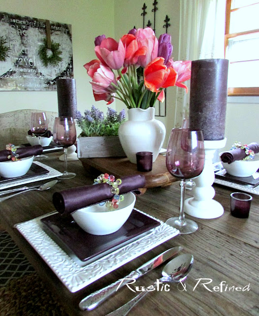garden inspired centerpiece on a spring table setting