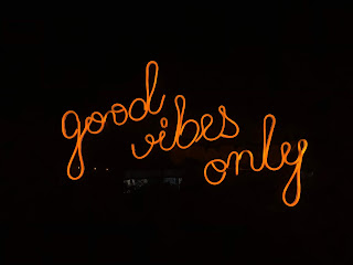 Good vibes only neon sign in orange and black