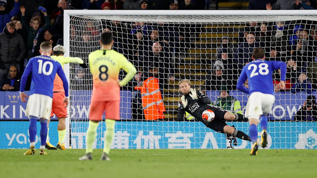 Kasper Schmeichel saves Sergio Aguero's penalty during Man City 2-1 win away at Leicester