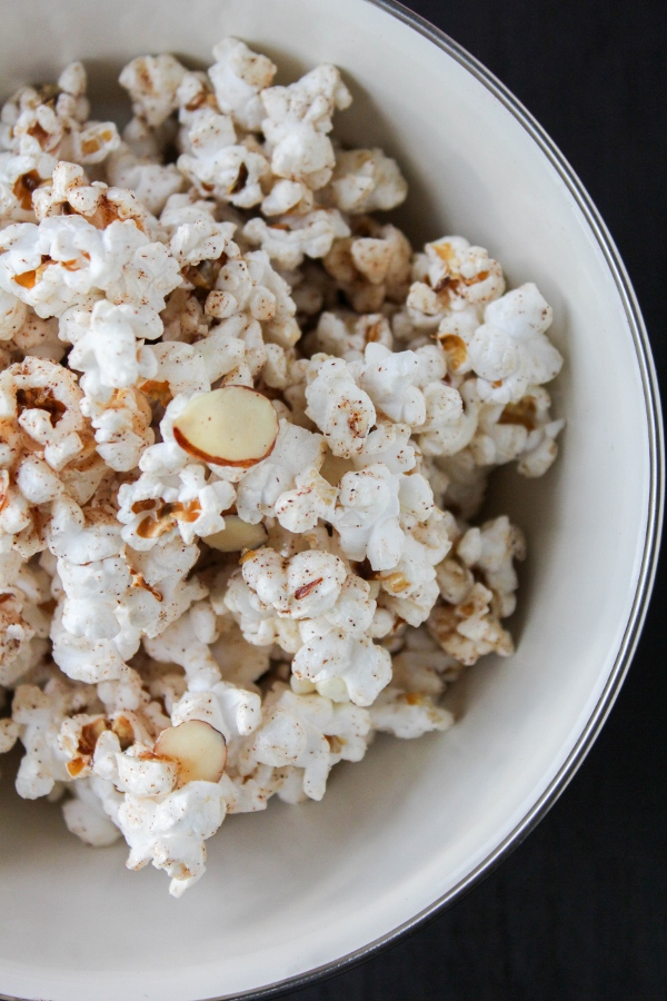 Satisfy both your sweet and salty cravings with this simple and delicious Cinnamon Almond Popcorn! It's a wholesome snack that the whole family will love.