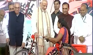 modi-distributed-equipment-to-divyangs-and-elderly-people/