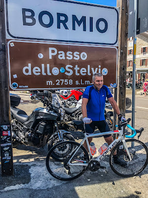 cycling Stelvio Pass climb by bicycle full carbon road bike mtb ebike rental in Bormio and Prato allo Stelvio