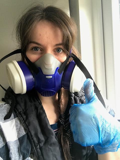 Girl DIYer in dust mask