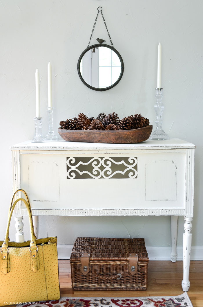 This beautiful console table in the entry was not so pretty before it was given a makeover with paint.  See the full project at www.andersonandgrant.com