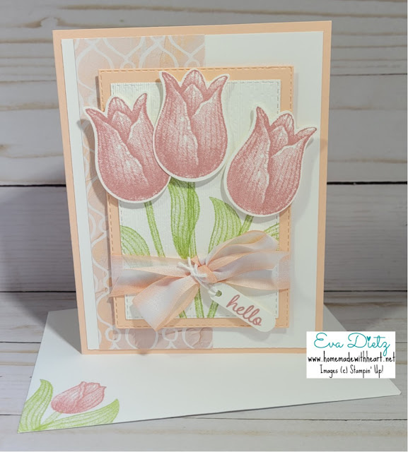 three pink tulips with pink bow on a layered card