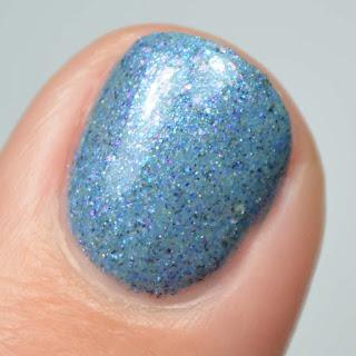 blue nail polish macro