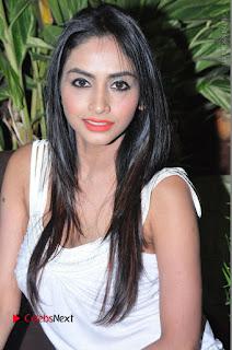 Actress Model Pooja Sri Stills in White Short Dress at F Club pre soft Launch  0064.JPG