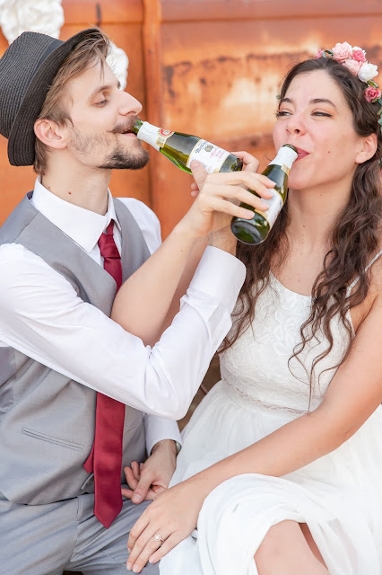 cider toast between bride and groom at micro wedding