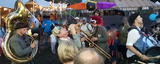 Just So Festival Lantern Parade Baghdaddies playing accompaniment leading the revellers