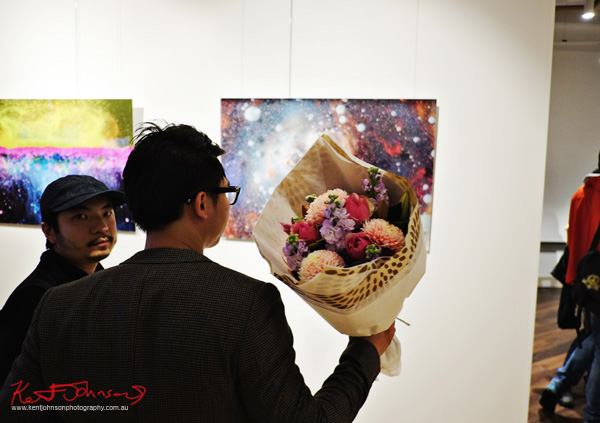 Artist with flowers and art, Love Letter - at 541 Art Space - Street Fashion Sydney by Kent Johnson.