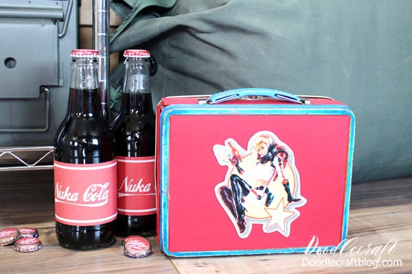 Again, scatter them on the floor and also use some stickers to top new bottles of soda as well. Can you tell how I made my Nuka Girl lunchbox?  **Secret is, it's a Superman lunchbox. I just covered the front and edges with red paper and then stuck my Nuka Girl Magnet, that I made for my hubby for Christmas, on the front. You could make this easily from a small cardboard box too!  All the details on this Nuka Girl magnet and other Fallout 4 themed magnets are on this post here.