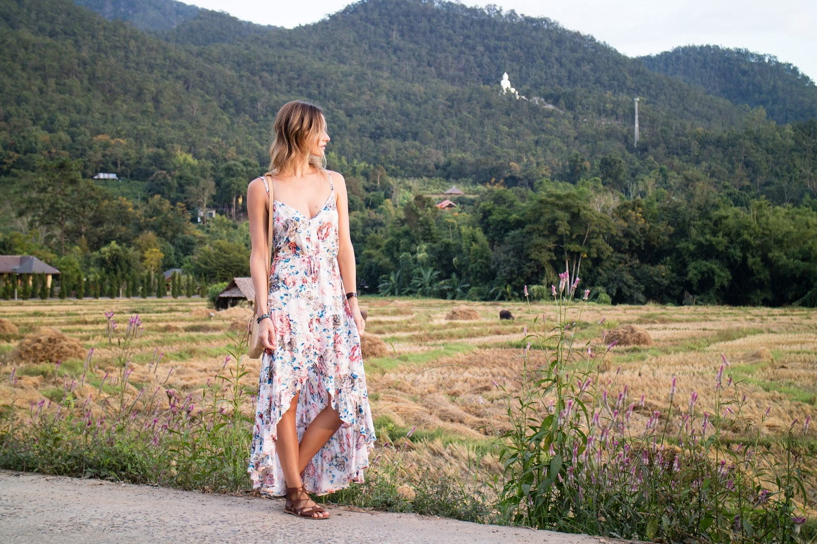 fashion and travel blogger, alison hutchinson is wearing an Auguste the Label floral dress in Pai, Thailand