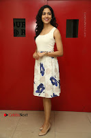 Actress Ritu Varma Stills in White Floral Short Dress at Kesava Movie Success Meet .COM 0023.JPG