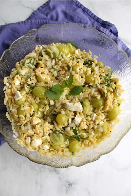 big serving bowl of grape mint and orzo salad