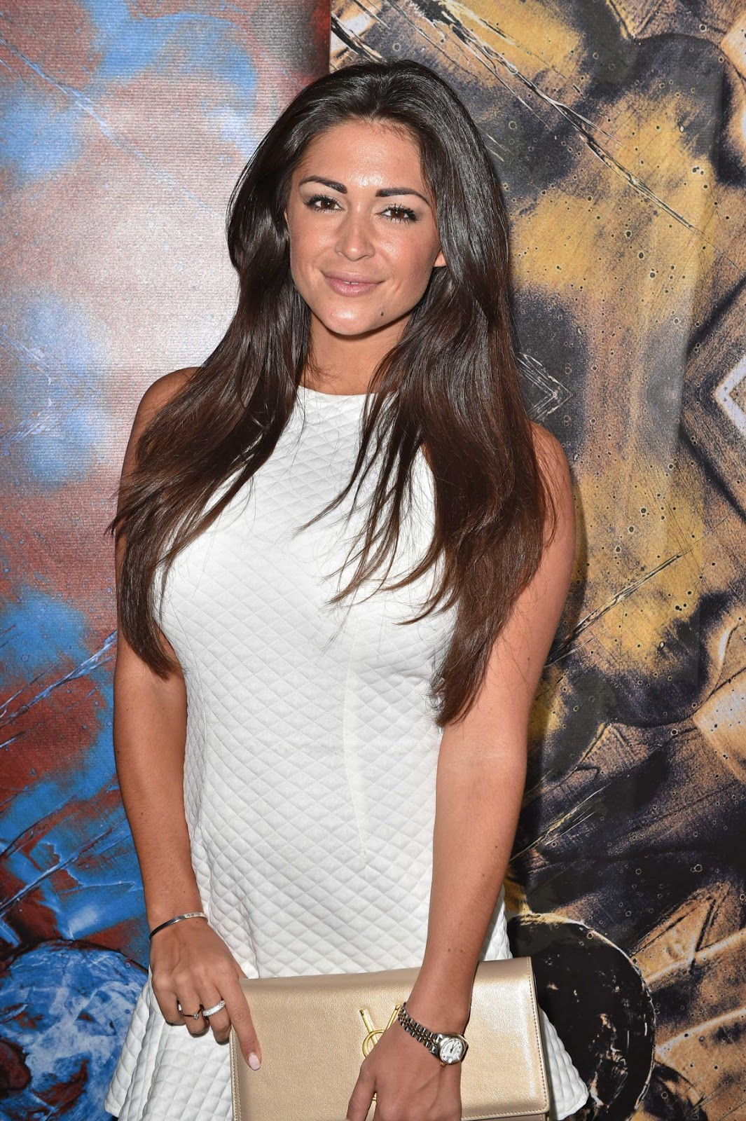 HD Photos of Casey Batchelor in white dress at Guirado Suite Press Launch in London