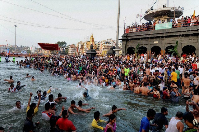 Devotees Taking A holy dip during Kumbh Mela festival.